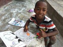 海地的男孩着色 免版税库存照片