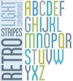 海报减速火箭的轻的镶边字体,浓缩的大写字目  免版税图库摄影