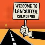 海报在手中,文本欢迎向兰卡斯特,加利福尼亚 库存例证