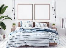 海报大模型在新的斯堪的纳维亚boho卧室 免版税库存图片