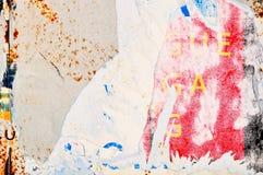 海报纹理被撕毁的墙壁 免版税库存图片