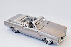 海氏,乌克兰- 2017年3月1日:银色玩具驾驶低底盘汽车兜风者c的微型拷贝 免版税库存图片