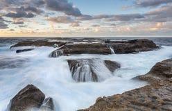 海洋几乎采取的搁浅的岩石渔夫 免版税图库摄影