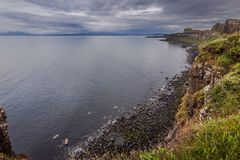 海洋苏格兰男用短裙岩石 库存照片