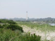 海洋雾和灯塔 免版税库存照片