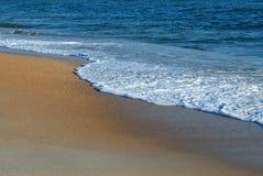 海浪和沙子 库存图片