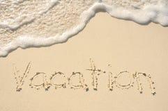 海滩书面的沙子假期 免版税库存照片