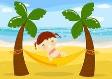 海滩女孩吊床少许掌上型计算机 免版税图库摄影