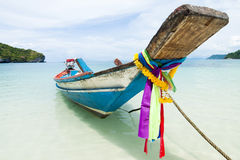 海滩小船长期坐尾标 免版税图库摄影