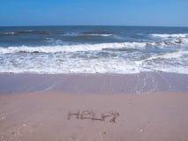 海滩帮助符号 图库摄影