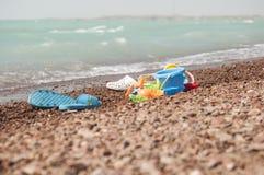 海滩开玩笑沙子玩具 免版税库存图片
