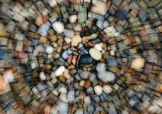 海滩弄脏了湿的小卵石 库存图片