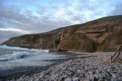 海滩当前石头 库存照片