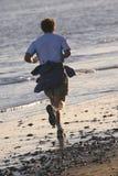 海滩慢跑者 图库摄影