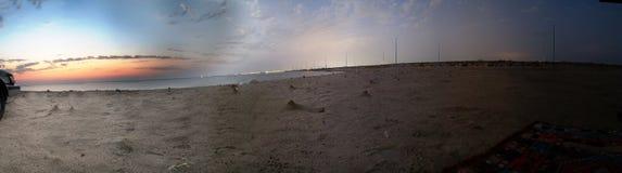 海滩日落微明 免版税库存图片