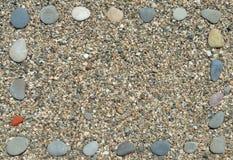 海滩框架小卵石 免版税图库摄影
