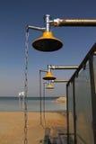 海滩海运阵雨 库存照片