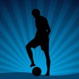 海滩球员足球 免版税图库摄影