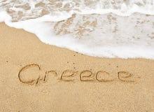 海滩电话卡希腊沙子海运 库存照片
