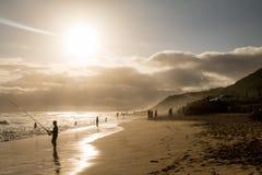 海滩的渔夫 免版税图库摄影
