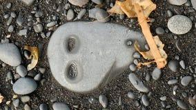海滩的石外籍人 库存图片