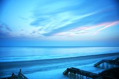 海滩的长的曝光在日落的 库存照片
