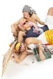 海滩组人坐的主题年轻人 免版税图库摄影