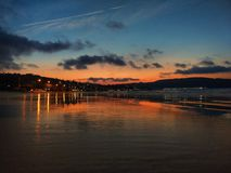 海滩风险感受产生慢的软的日落非常通知 免版税库存照片
