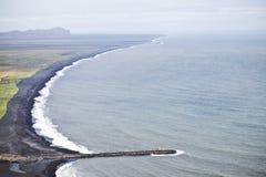 海滩黑色沙子 免版税图库摄影