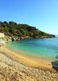 海滩corfu nissaki垂直 库存图片