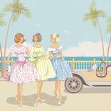 海的三名妇女 库存图片