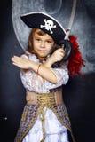 海盗服装的小女孩 日历概念日期冷面万圣节愉快的藏品微型收割机说大镰刀身分 免版税图库摄影