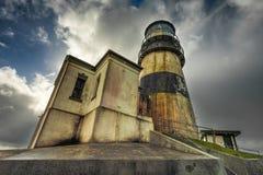 海角失望灯塔在剧烈的天空下 库存照片