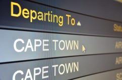 海角离去的飞行到城镇 免版税库存照片