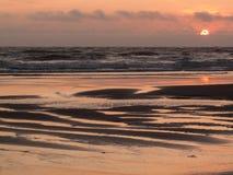 海角从海滩的监视日落 免版税库存图片