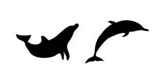 海豚剪影向量 免版税库存照片