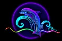 海豚从海洋和幻灯片跳在波浪 免版税图库摄影