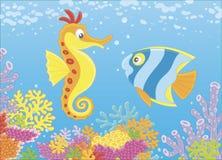 海象和蝴蝶鱼在珊瑚中 免版税库存图片