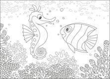 海象和蝴蝶鱼在珊瑚中 免版税库存照片