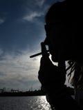 海边吸烟者 图库摄影