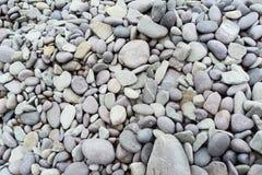 海运向背景扔石头 灰色石背景-小卵石向纹理扔石头 免版税库存图片