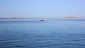 海运的二位孤独的渔夫 免版税库存图片