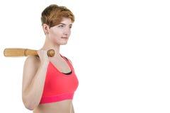 海滩健康生活方式体育运动日落走 一个女孩拿着一个棒球棒,在白色背景 水平的框架 免版税图库摄影