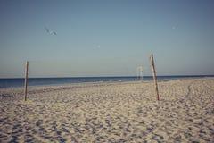 海滩净掌上型计算机沙子排球 免版税库存图片