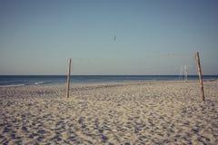 海滩净掌上型计算机沙子排球 免版税库存照片