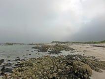 海滩和沉思的天空 库存照片