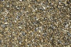海滩小卵石石头纹理 库存图片
