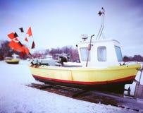 海滩小船danang捕鱼nam viet 在葡萄酒生动的颜色的艺术性的神色 免版税库存图片