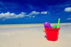 海滩开玩笑沙子玩具 图库摄影