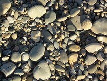 海滩当前石头 图库摄影